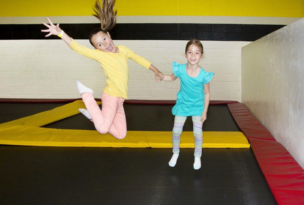 Kids Jumping on Indoor Trampolines