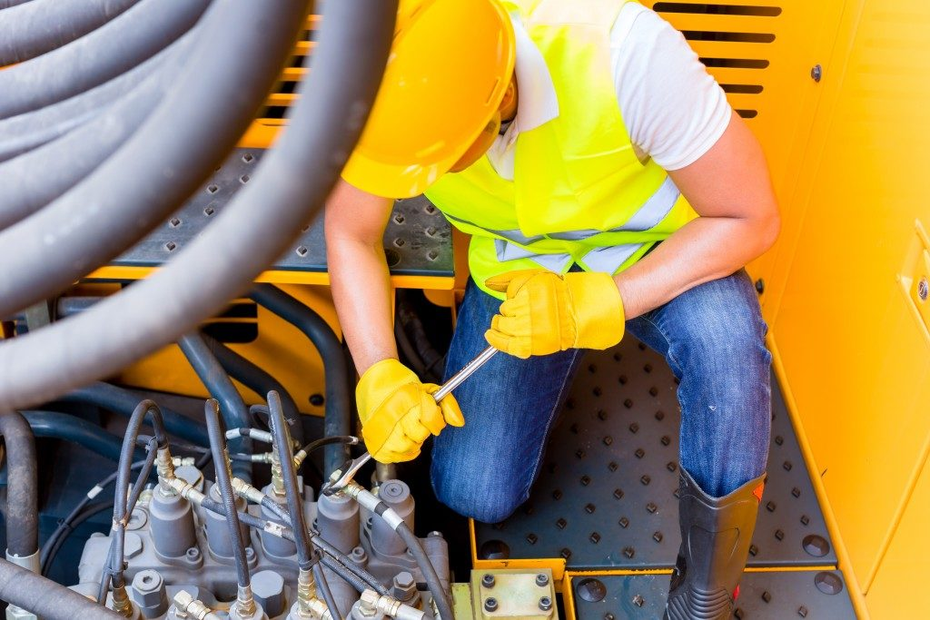 Asian motor mechanic repairing construction or mining machine motor