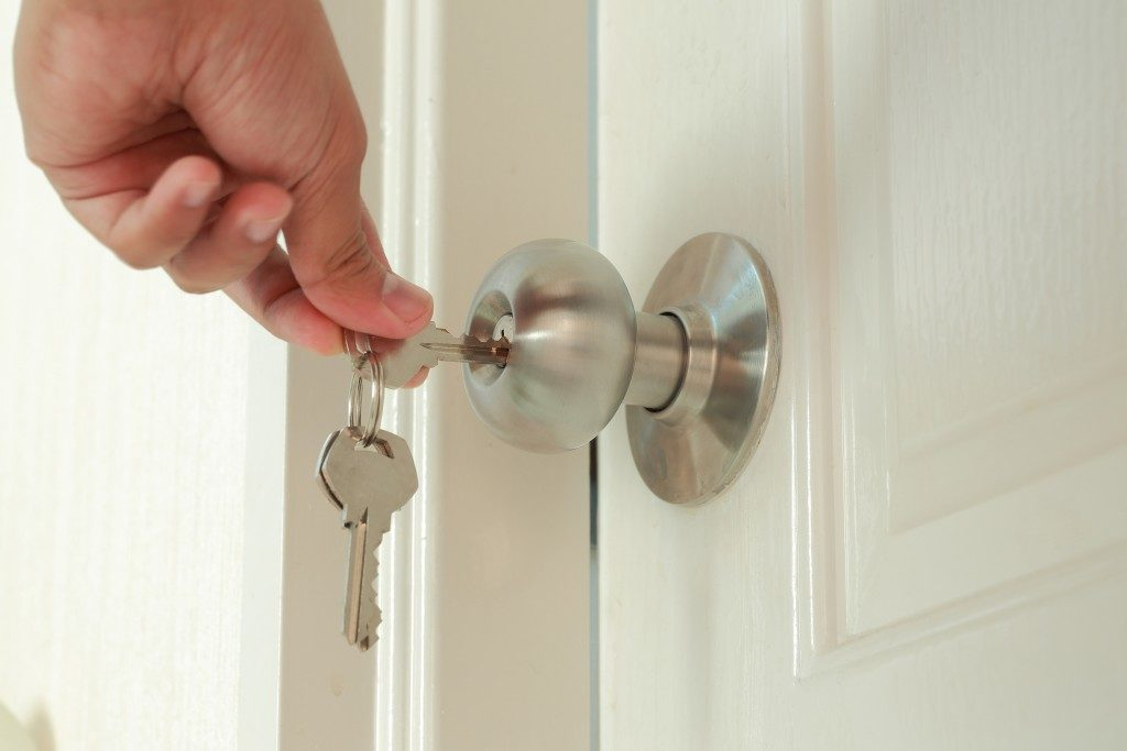 person locking the door