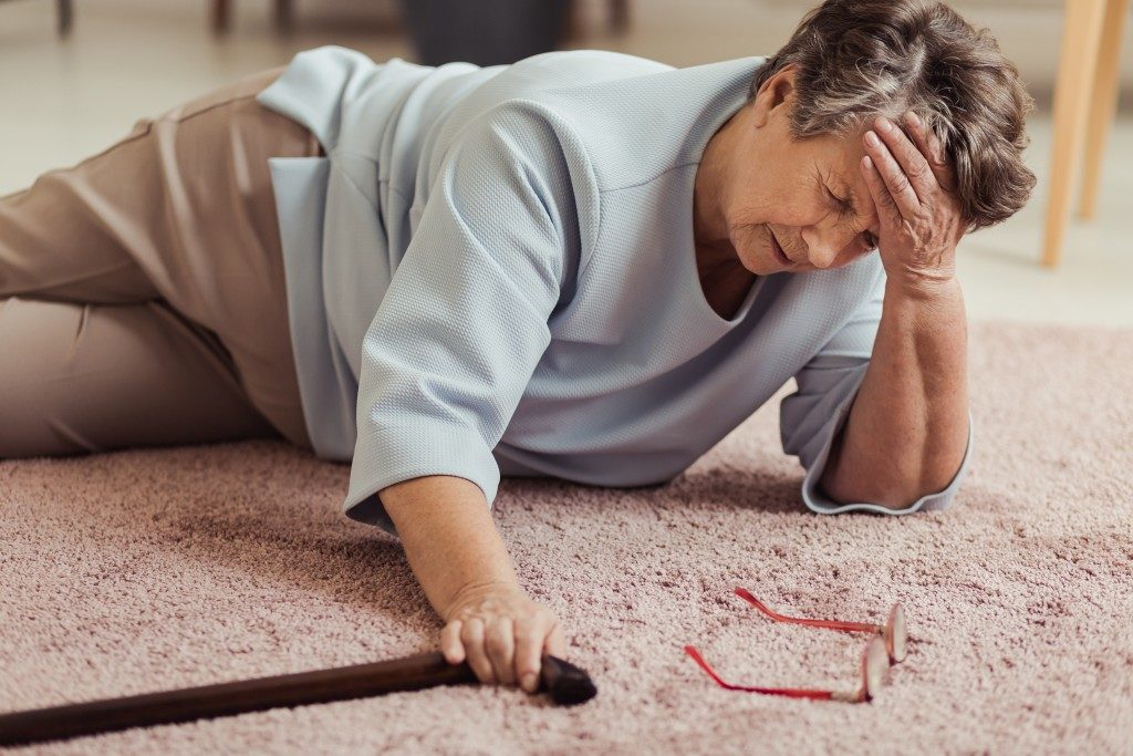 elderly woman on the floor after tripping