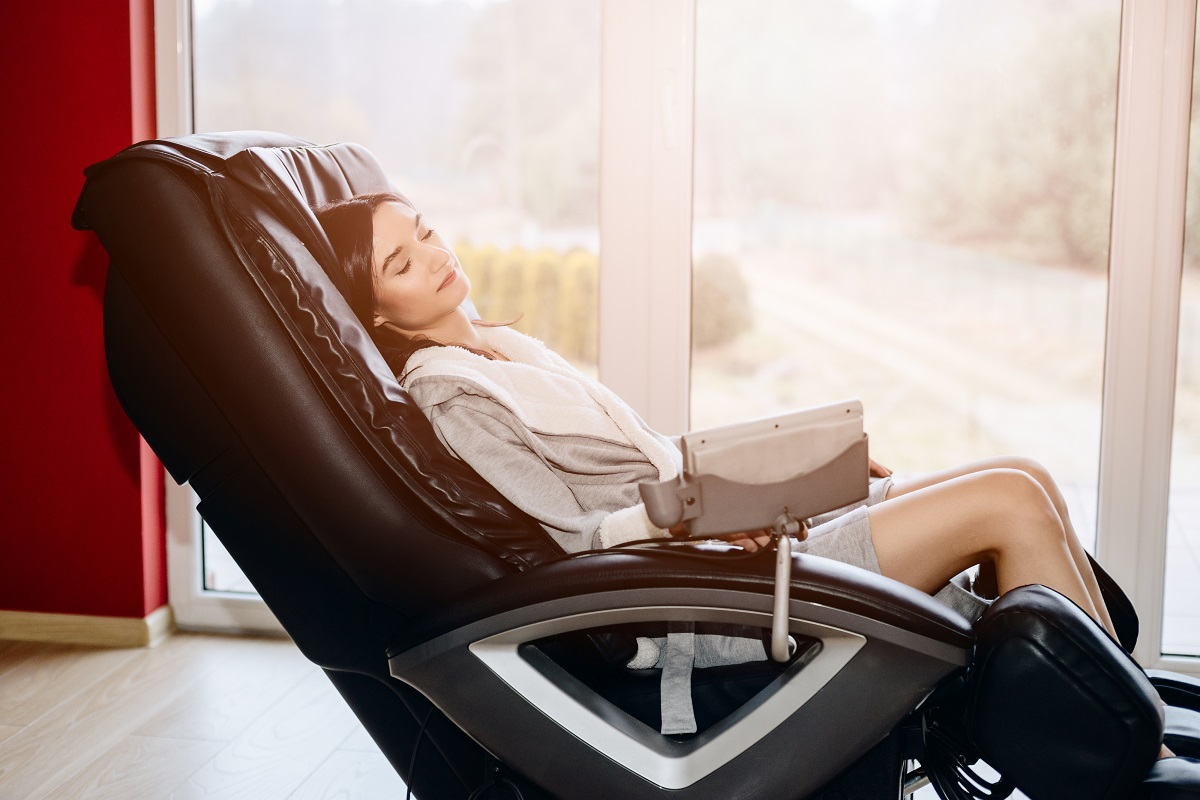woman relaxing in a massage chair