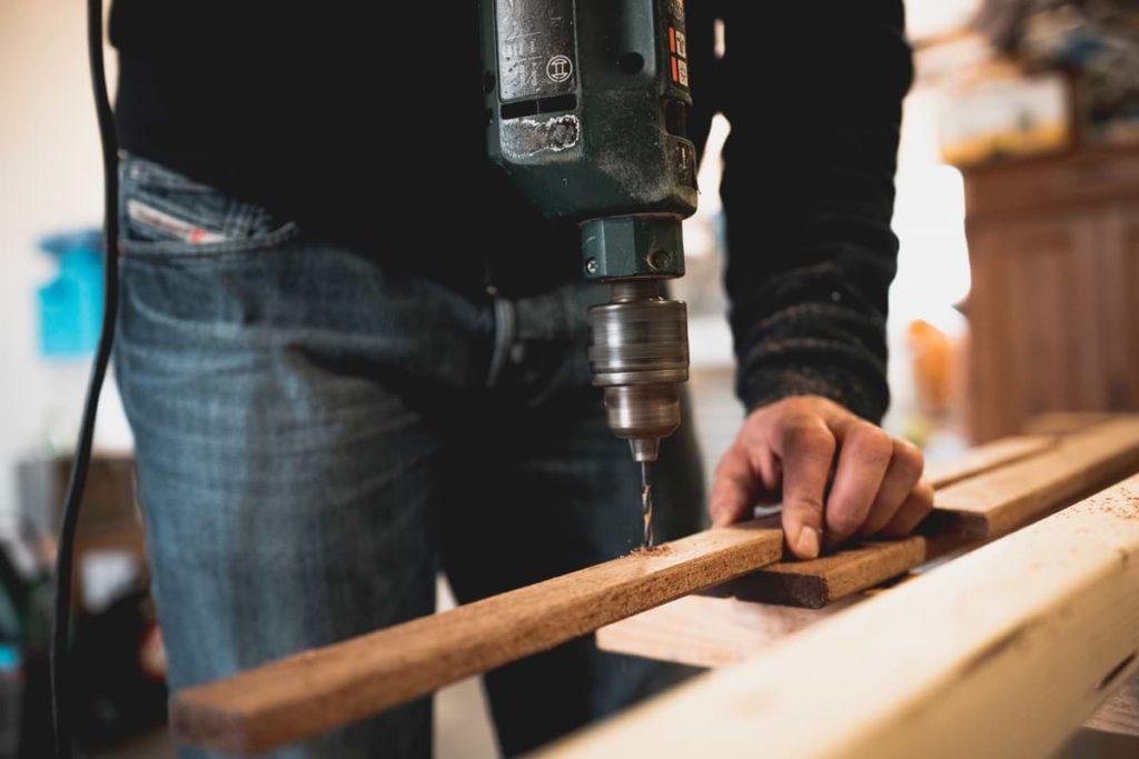 man drilling his wood