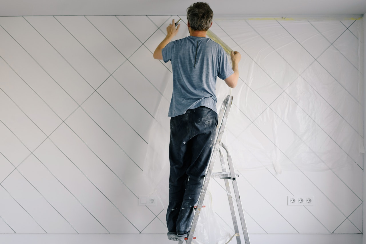 man painting walls