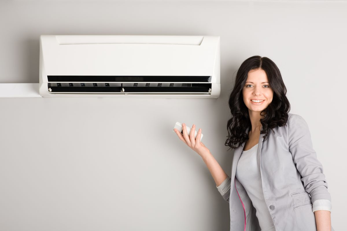 woman operating air conditioning unit