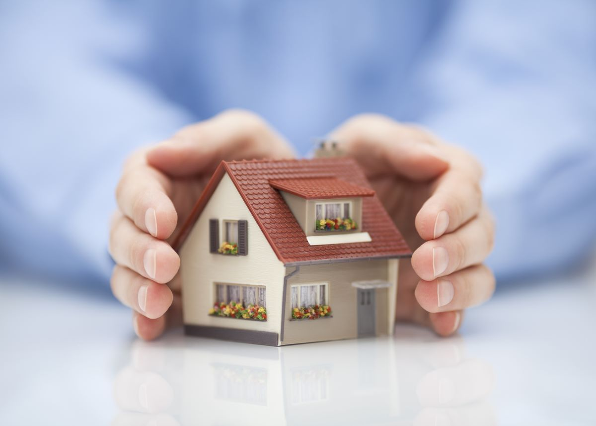 holding miniature house model