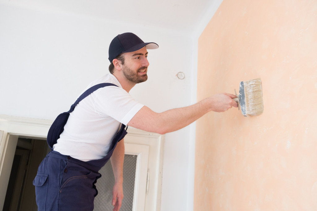 person repainting wall